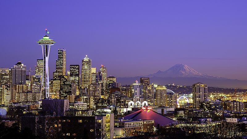 Seattle-skyline-at-night-with-Mt-Rainier-in-the-distance-Web